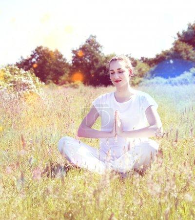 Smiling yoga girl meditating for joyful retreat, colorful retro filter