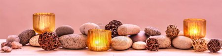 Photo for Concept of pampering beauty, relaxing massage, pure spirituality, ayurveda or sensuality with mineral pebbles and warm candles, panoramic wallpaper - Royalty Free Image