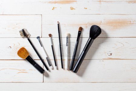 Lineup of artist makeup accessories with eyeshadow and blush brushes