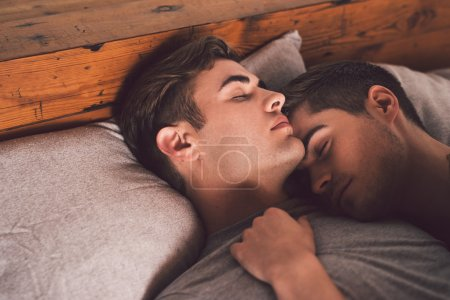 gay couple sleeping arm in arm