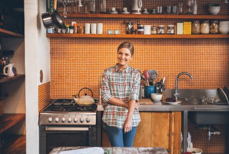 woman leaning against counter in kitchen