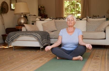 woman sitting in lotus pose