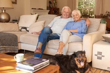couple with family dog