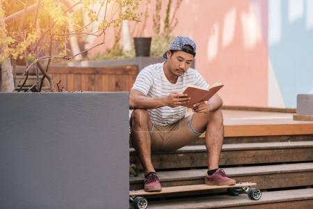 man in a cap reading