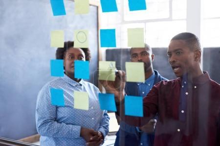 African businesspeople brainstorming