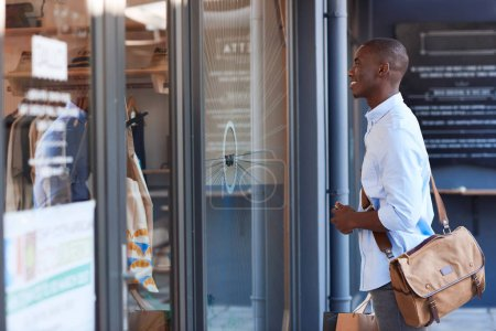 African man carrying shopping bags