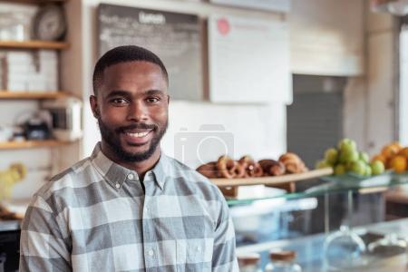 entrepreneur smiling in cafe
