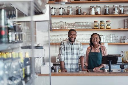 entrepreneurs standing behind counter of cafe