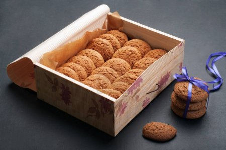Oatmeal cookies in a box on a dark background. Useful sweets