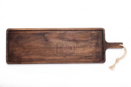 Photo for A long brown wooden cutting board that can be used for carrying food (tray), on a white background. View from above. Isolated object. Kitchen equipment for bars and cafes - Royalty Free Image