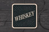 coaster for glass with inscription Whiskey