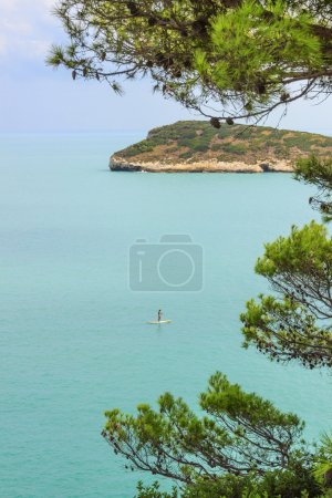 Gargano coast: Baia di Campi beach,Vieste-(Apulia) ITALY-In the distance the bather who practices standuppaddling and in the background the island Campi.