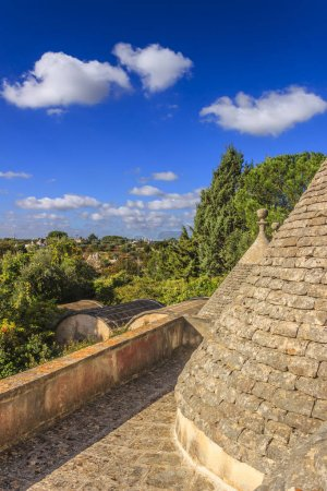 Italy landscape: Apulia countryside. Valle d'Itria, territory of Cisternino. View from the roof of a trullo: hills with olive trees. Typical example of rural Apulian landscape.