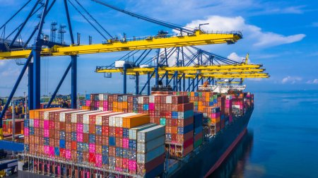 Container cargo ship at industrial port in import export busines