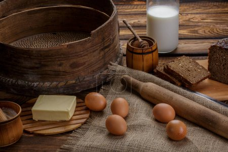 Ingredients for cooking, eggs, honey, bread, flour and milk