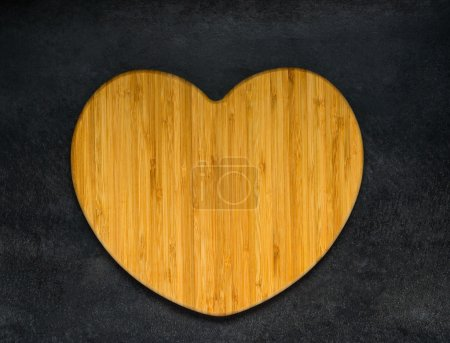 Photo for Wooden Heart Shaped Chopping Board - Royalty Free Image
