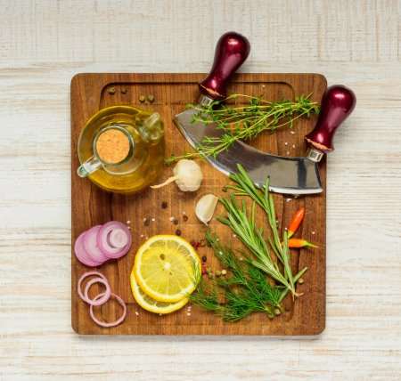Photo for Herbs, Spices and Seasoning with Cooking Ingredients on Wooden chopping board - Royalty Free Image