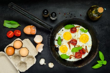 Photo for Fried Eggs in Cooking Pan with Eggs, salt and Pepper - Royalty Free Image