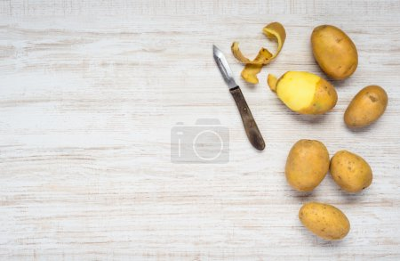 Photo for Copy Space Area with Peeled Patatoes and Peeler - Royalty Free Image