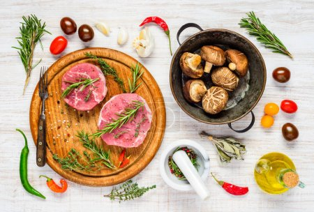 Photo for Top View of Raw Meat with Mushrooms and Cooking Ingredients - Royalty Free Image