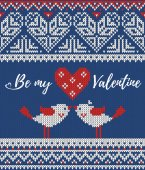 Seamless pattern on the theme of holiday Valentines Day with an image of the Norwegian and fairisle patterns Heart birds in a kiss sign Be my Valentine on a blue background Wool knitted texture