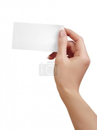 Photo for Beautiful female Hand holding paper business card on white background. Gift card, cutaway, graphic design. - Royalty Free Image