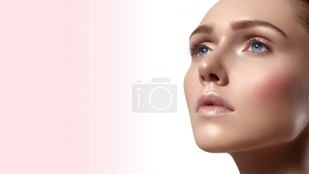 Photo for Beautiful young woman with perfect clean shiny skin, natural fashion makeup. Close-up woman, fresh spa look. Healthy beauty - Royalty Free Image