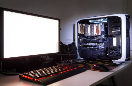 Photo for Custom built gaming computer with white screen, keyboard, mouse and audio speakers - Royalty Free Image
