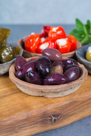 Mediterranean appetizer antipasti tapas bowls with green and cal