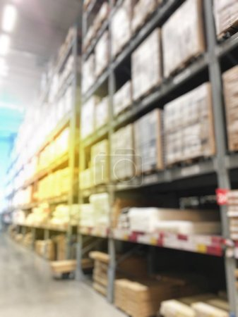 blurred of warehouse and storehouse with shelves in supermarket