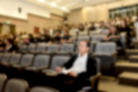 Photo for Education concept. Abstract blurred background image of education people, business people and students sitting in conference room or large hall with screen and projector for showing information. - Royalty Free Image