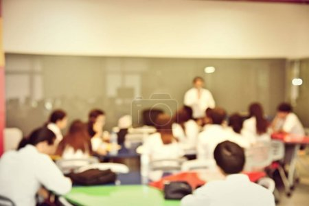 Photo for Education concept, Abstract blurred background image of students and business people  studying and discuss in large hall profession seminar with screen and projector for showing information. - Royalty Free Image