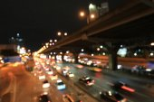 Abstract circular bokeh motion lens blur backround of city and street light or Bokeh light from car in street in night time. Bangkok Expressway Thailand.