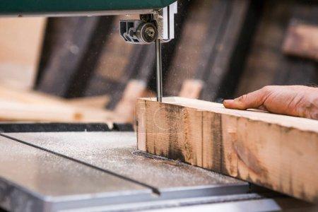 Man grinds wooden log