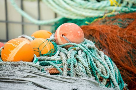Fishing nets and floats on wooden dock
