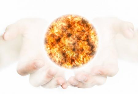 Hands holding a sun.