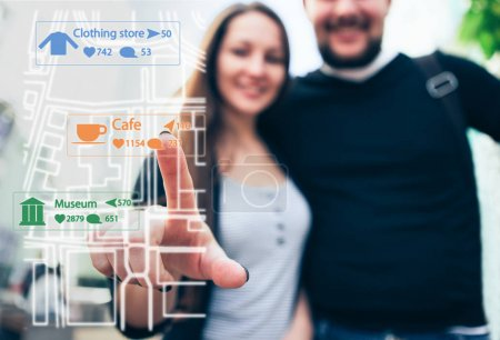 Woman traveler with boyfriend points a finger on the map. View through the phone screen.
