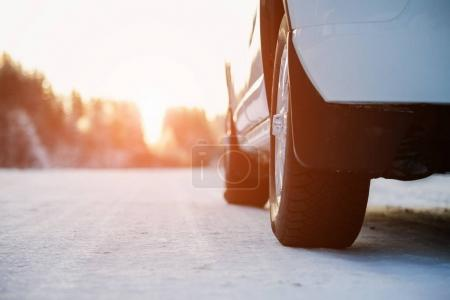 White car on a winter road