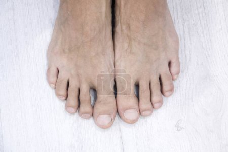 top view of Male nail and feet on white background,This has a clipping path
