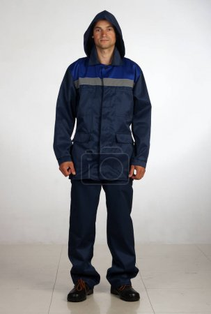 A man in overalls and work wear