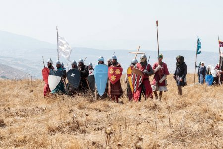 Photo for Tiberias, Israel, July 01, 2017 : Participants in the reconstruction of Horns of Hattin battle in 1187 dressed in crusader suits, are preparing to repel an attack on the battlefield near Tiberias, Israel - Royalty Free Image