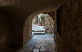 Narrow passage between houses in the old city of Jerusalem near to the gate Jaffa Gate in the Old City in Jerusalem, Israel