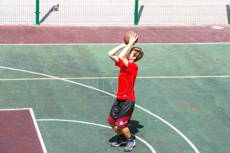 Boy on a basketball court