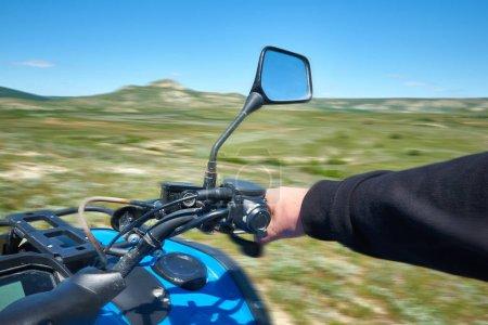 Riding on a quad bike