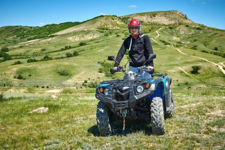 Rider on a quad bike in the mountains