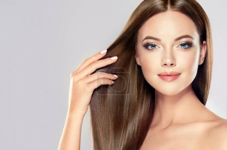Photo for Beautiful model girl with shiny brown straight long  hair . Care and hair products . - Royalty Free Image