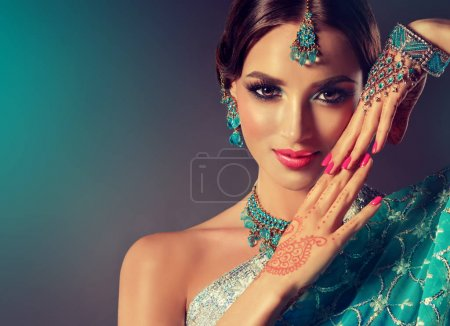 Photo for Portrait  smiling of beautiful indian girl. Young indian woman model with blue jewelry set  . Traditional Indian costume saree  . Bollywood  style - Royalty Free Image