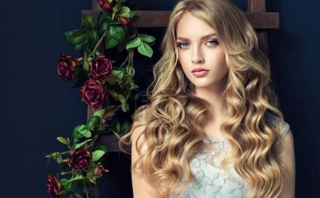 Blonde fashion  girl with curly hair