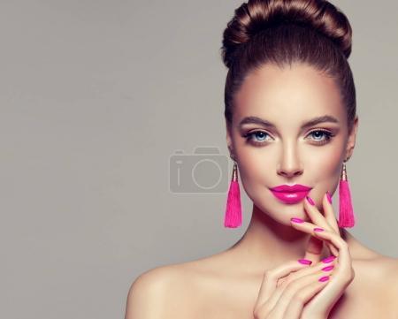 Beautiful model girl with pink fuchsia manicure on...