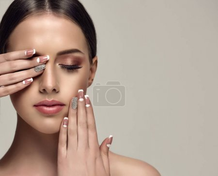 Beautiful model girl with a beige French manicure ...